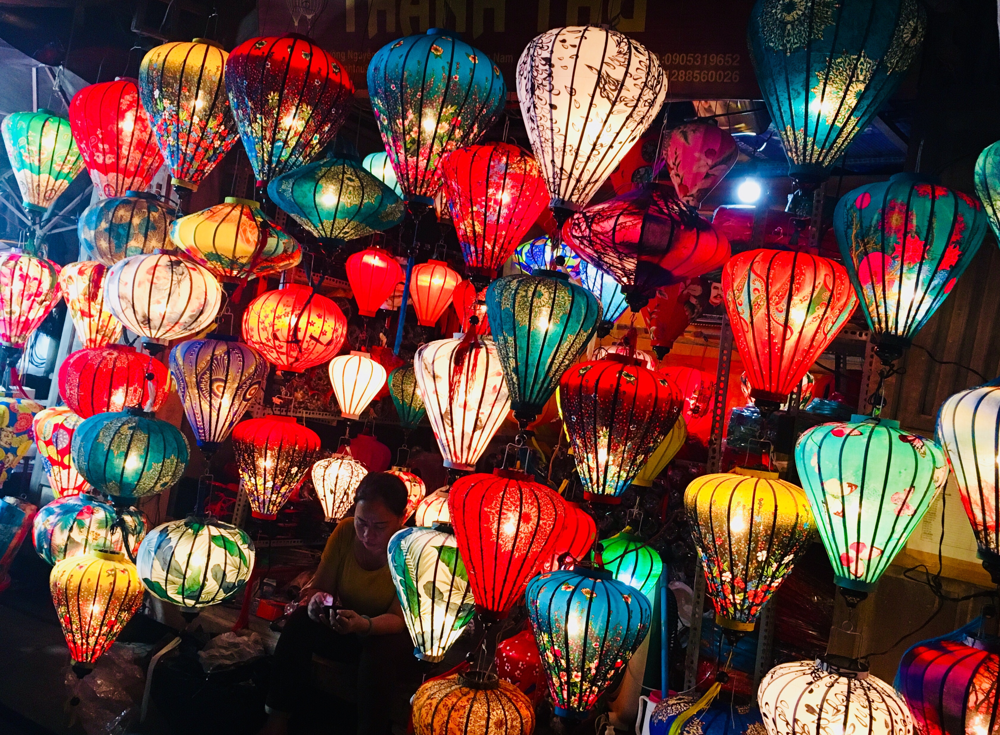 Beautiful glowing silk Vietnamese lanterns for sale at a street vendor in Hoi An Vietnam